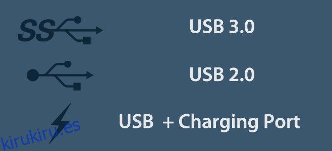 Identifique los puertos de carga y USB 3.0 observando los símbolos junto a ellos